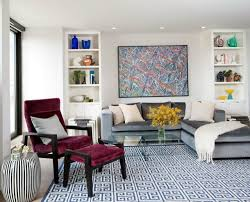 grey couch blue rug