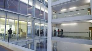group contemporary office. attractive diverse business group walking through one floor of a large contemporary office building in slow motion stock footage video 5699519