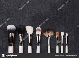 row of diffe makeup brushes in white covering stock photo