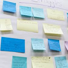 professional development community engagement na university  blue green and yellow post it notes on a whiteboard
