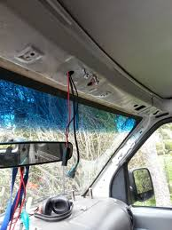 how to install a cb radio in an econoline 4th generation 1992 see where the bolts and the wires are sticking out just above the rearview mirror that s a good place to put your radio