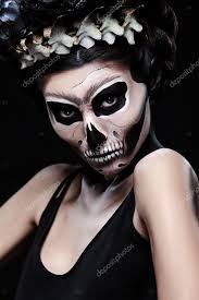 woman in style frida kahlo concept skeleton or skull makeup stock