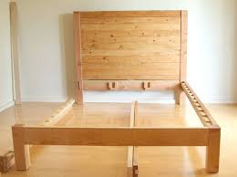 first place the headboard and footboard where you would like the bed to be lift the 2 6 side rail and slide the bed rail bracket claws into the slots so