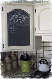 upper kitchen cabinets pbjstories screenbshotb: paint center of cabinet door with chalkboard paint and use as message center quote of