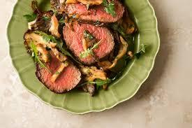 venison steak with onionushrooms