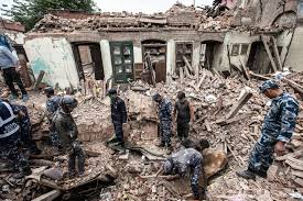 living through the earthquake then grabbing a camera proof picture of rescuers digging through rubble after the 2015 7 9 magnitude earthquake in