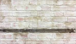 lime washed faux brick wall hand sculpted and painted by our decorative painters and sculptors