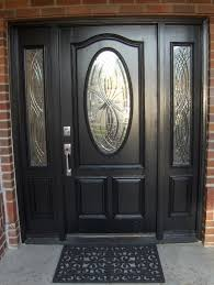we can take a sun and weather beaten door and strip and refinish it or sand prime sand and paint it like this black door here ask us about the new finish
