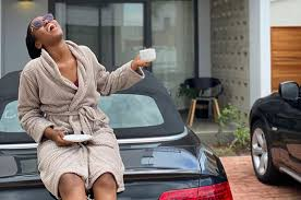 A very happy looking Mzvee shows off beautiful house and cars