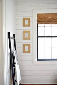 shiplap with a twist she added gold furniture studs to add a little glam