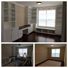 office built in with two wall of cabinetry including window seat desk with