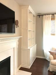 ikea built in book shelves using billy book cases and sektion ikea cabinets wood trim crown and custom wood panels