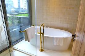 a bathtub with an outside view at this spa inspired bathroom not every room gets this view and bathtub depends on your room type