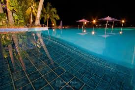 infinity pool night. Nightime Shot Of The Infinity Pool At Iririki Island Resort In Port Vila, Vanuatu. Night