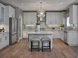 Fancy big open kitchen ideas for home Finnish Men Kitchen With White Cabinets Kimberley Homes Kitchens Photo Gallery Edmonton Home Builders