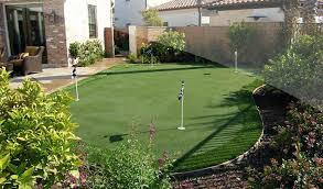 home putting green a putting green area beside a house four flags feature brick fence system