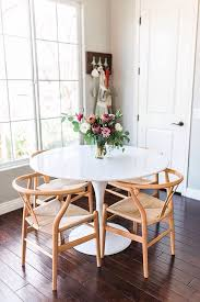 small and cute white tulip table and four wishbone chairs