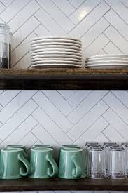 the tiles in this backsplash are twice as long as standard subway tiles the size
