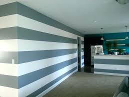 Stripe painted walls Painting Multicolored Striped Paint Stripe Painted Wall Painting Multi Colored Stripes On Walls Using Painters Tape For Blue Claudiakollertinfo Striped Paint Moonhouse