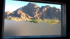 window decoration made to mirror the image of the mountain with frosted copyright accent by masters inc 2016 all rights reserved