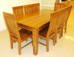 teak dining room table arrangement