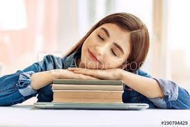 student sitting at desk hands folded.  Sitting Pleasant Teenage Girl Sitting At The Table And Sleeping With Her Head For Student Sitting At Desk Hands Folded O