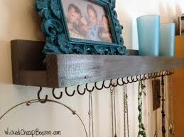 Put hooks under a shelf to hang necklaces! Another good one on this list of  11 DIY necklace holders is to use a long frame, add bars with hooks for a  tiered ...