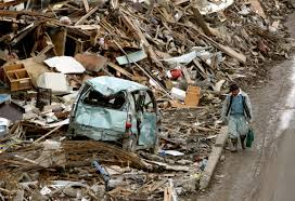 kb earthquake and tsunami kelly barnes  a man walks past the damage in the northern coastal town of ofunato were destroyed after