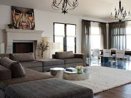 sears area rugs with contemporary family room and dark gray sofa coffee table silver carved stone fireplace sheer window treatment
