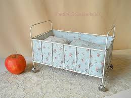 vintage metal doll bed on tin wheels 1950s doll cot with mattress original bedding for 8 inch baby doll old large scale dollhouse crib