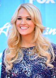 carrie underwood long blonde curly hairstyle for prom