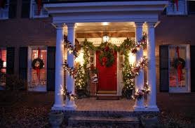 how to hang garland around front doorfor Christmas with Magnolia and Pine