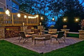 stunning front yard landscape with garden and string lights