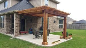 backyard patio covers brick walls concrete floors wall decoration round ottoman square table tall back chairs