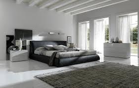 bedroom furniture for men. wide ceiling beams over cool black and white bedroom interior set with brown plaid area rug idea designed for men furniture o
