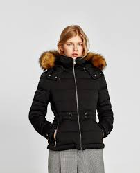 black quilted jacket with faux fur trimmed hood