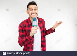 performer guy singer in a shirt with a microphone in his hands on ...