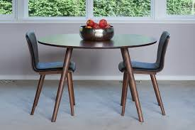 the article seno round dining table and chairs in a light filled room