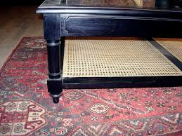 anglo indian anglo indian style ebonized wood glass and cane coffee table for