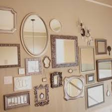 I like the idea of silver frames but wold love to do one mirror and the  rest beautiful, glamorous black & white photos of my mom, grandmas,  great-grandmas, ...