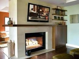 fireplace with tv above corner
