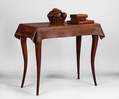 wendell castle american born 1932 fine rare stack laminated walnut trompe l oeil table