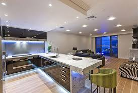 marble countertop with kitchen light fixtures over island in modern kitchen image