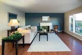 living room accent wall refined living room blue accent wall wood flooring living room accent wall