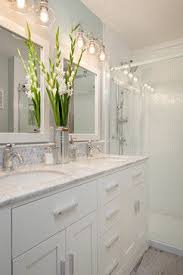 light neutrals you need more beige i think like the lights backsplash detail above vanity steveston townhouse traditional bathroom vancouver the bathroom lighting fixtures ideas