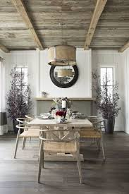 Reclaimed wood from The Vintage Wood Floor Company lines the ceiling and  gives a rustic feel to the dining room. A drum shade pendant by Lowcountry  ...