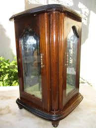 vintage vertical guard jewelry in noble wood etched glass doors interior in old stained glass