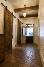 diy dutch door entry farmhouse with exposed beams sliding barn door transom window