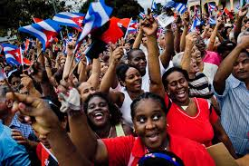 years after revolution  hundreds of ns wave the national flags expressing support for the regime of fidel castro and his brother raul castro during the annual celebration of