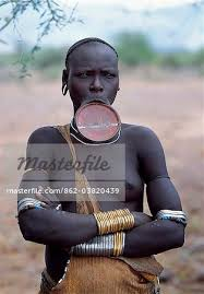 a mursi woman with a clay lip plate
